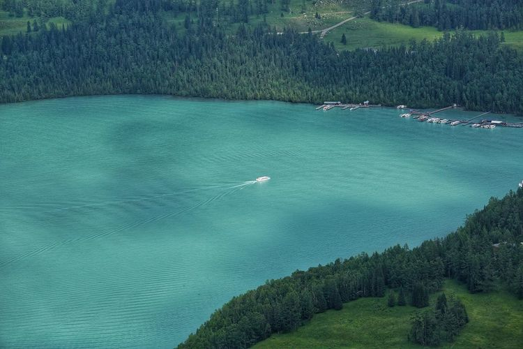 China Photos High Angle View Water Day Outdoors Nature Beauty In Nature Lake View Kanas Lake Green Color No People Scenics Sailing Ship Sailboat Sailing Forest Tranquility Nautical Vessel Wildlife & Nature Rural Scene Urban Landscape Tranquil Scene Xinjiang Of CHINA XinJiang Streamzoofamily