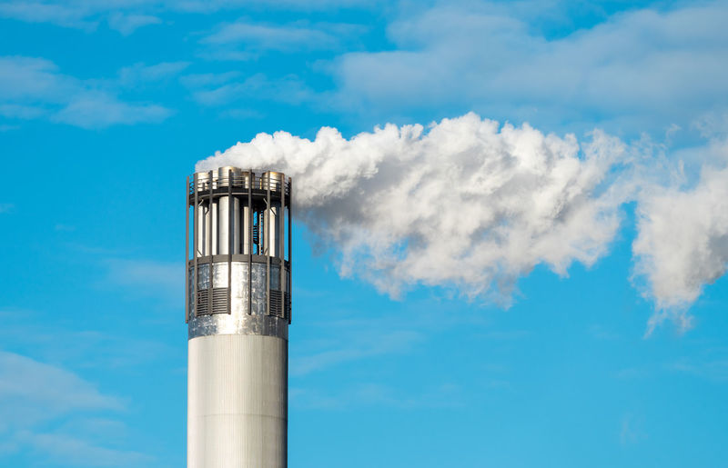 Smoke stack against blue sky