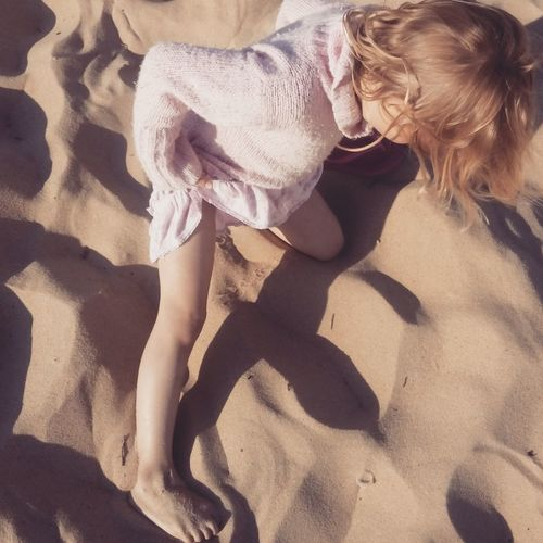 Full Length Of A Girl Playing In Sand