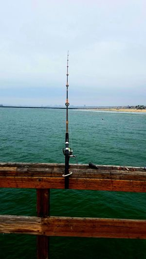 Fishing Pole Depth Distance Depth Of Field Segments Sections Pole Sea Beach Pier Freshness Fishing Lifestyles Fun Zen Meditation Activity Copy Space Backgrounds Leisure Activity Tranquil Adventure Enjoyment Pattern Beauty In Nature Breathing Space