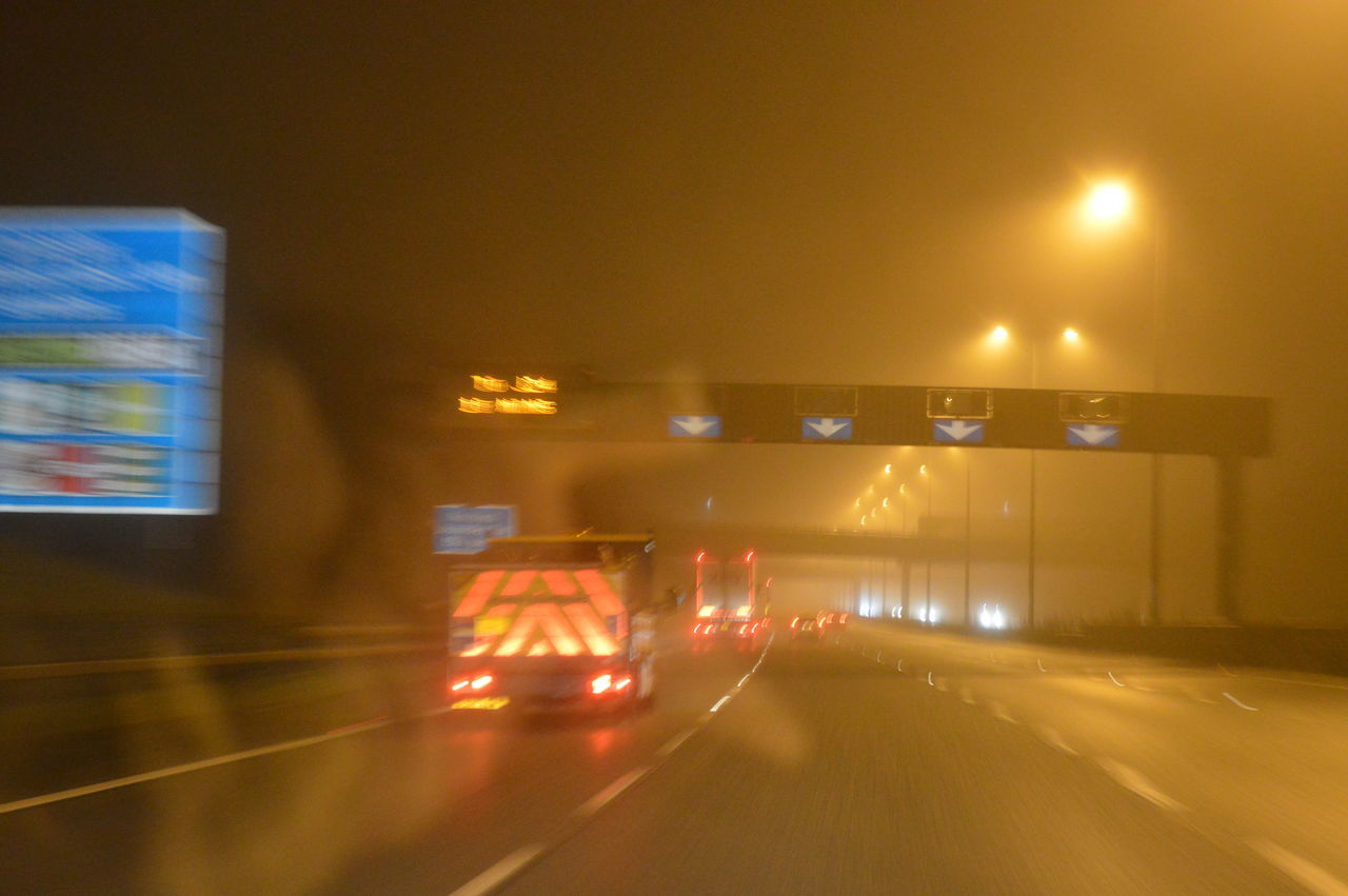 illuminated, night, transportation, blurred motion, lighting equipment, mode of transport, speed, land vehicle, road, outdoors, no people, city