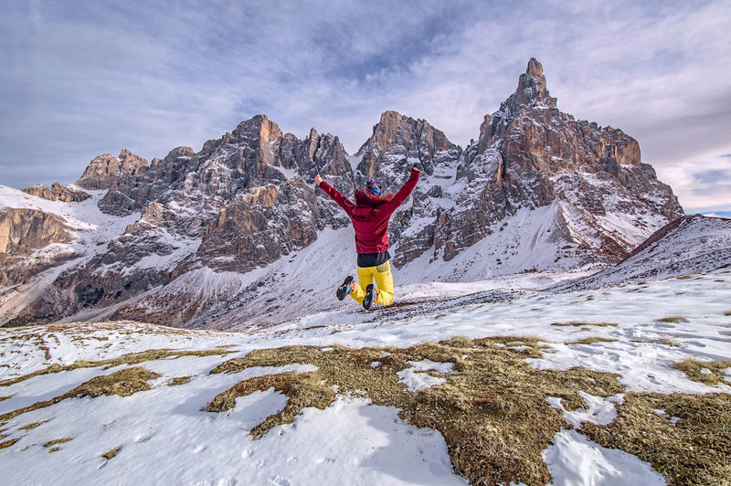 To the sky. Snow Winter Mountain One Woman Only One Person Women Outdoors Sky Mountain Peak Fun Adventure Jump Shot in Trentino  Trentino Alto Adige Dolomites, Italy Pale Di San Martino
