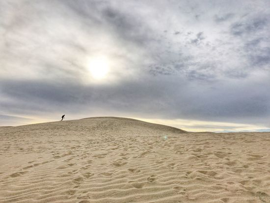 Walking up the hill Desert Sand Sky Nature Sand Dune Cloud - Sky One Person Outdoors Day Beauty In Nature Playadelingles Maspalomas SPAIN