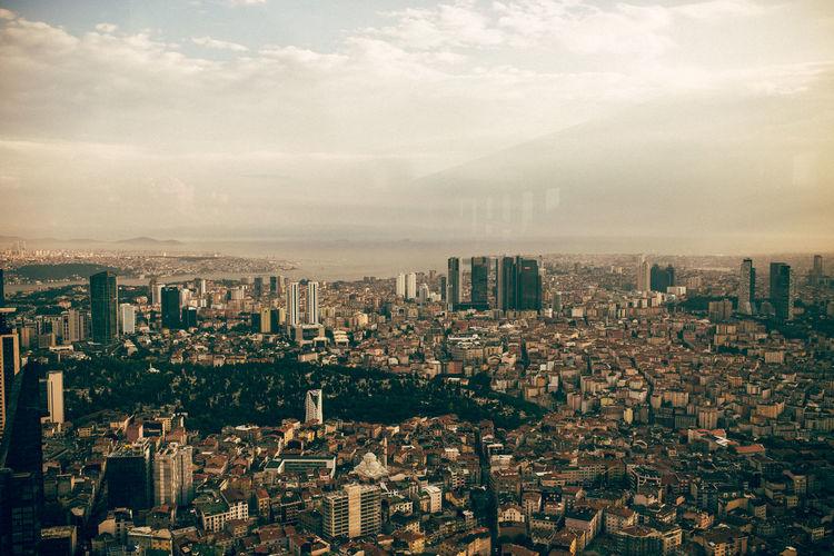 Aerial view of modern buildings in istanbul, turkey against sky