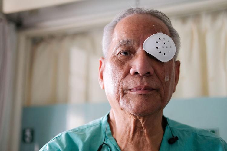 Close-up portrait of senior man at home