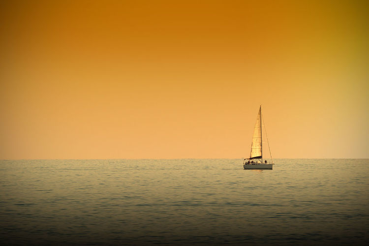 Activity Boat Holiday Horizon Over Water Orange Color Sailboat Sailing Sea Sunset Travel Water Yachting