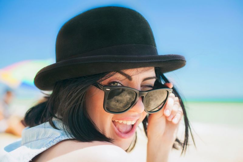 Young Adult Young Women Real People Two People Leisure Activity Togetherness Happiness Day Clear Sky Headshot Lifestyles Smiling Sky Fun Outdoors Eyeglasses  Portrait Friendship Cheerful Vacations Sunglasses Rayban Hat Beach Beachphotography