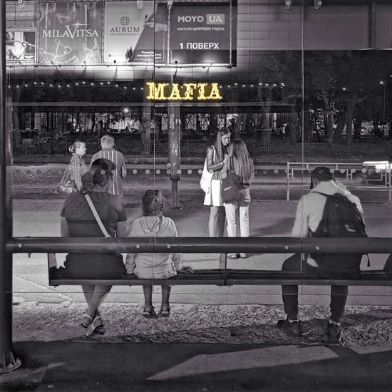 People sitting on bench in city