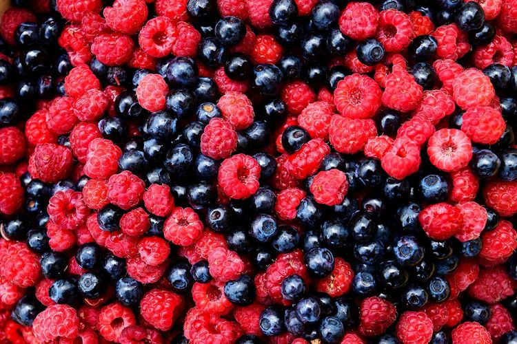 Full frame shot of blueberries and raspberries