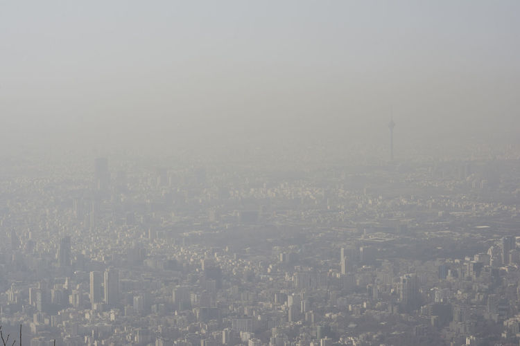 Aerial view of Tehran city from mountains side, air-polluted skyline. Smoke Winter Aerial View Air-polluted Architecture Building Building Exterior Built Structure City Cityscape Copy Space Day Environmental Problems Fog High Angle View Nature No People Office Building Exterior Outdoors Pollution Of The Environment Residential District Sky Skyscraper Smog Tehran, Iran