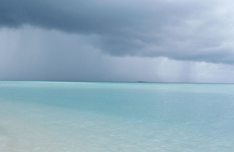 Blue Caribbean Sea Rain Sand Sea And Sky Showers Storm Cloud Weather Colour Of Life Chance Encounters Peaceful View Dramatic Sky Live For The Story