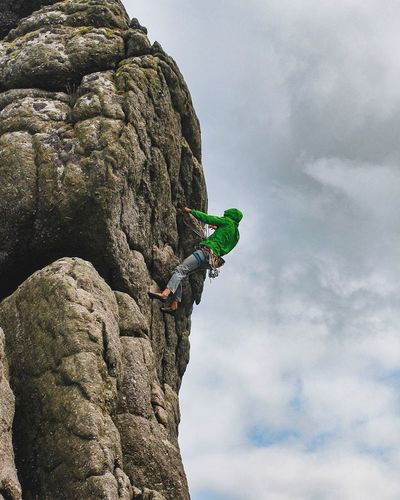 EyeEm Selects Adventure Rock Climbing Low Angle View RISK Climbing Day Sky One Person Outdoors Cloud - Sky Men Leisure Activity Cliff Challenge Sport Real People Nature Full Length Skill