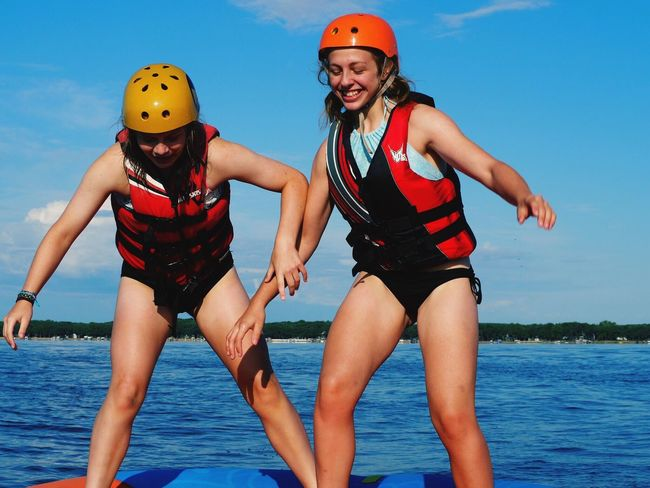 EyeEm Selects Lake Water Tubing Friends Helmets People Fell Standing Up Swimsuits Legs Arms Sky Daytime Sunlight Blue Outdoors Nature