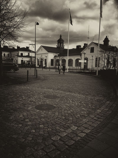 Trainstation in Katrineholm Building City City Life Cloud Cloud - Sky Cloudy Day Empty Lifestyles Monochrome Outdoors Overcast Road Sky The Way Forward Town Train Station Traveling Weather IPhoneography Travel Destinations Architecture