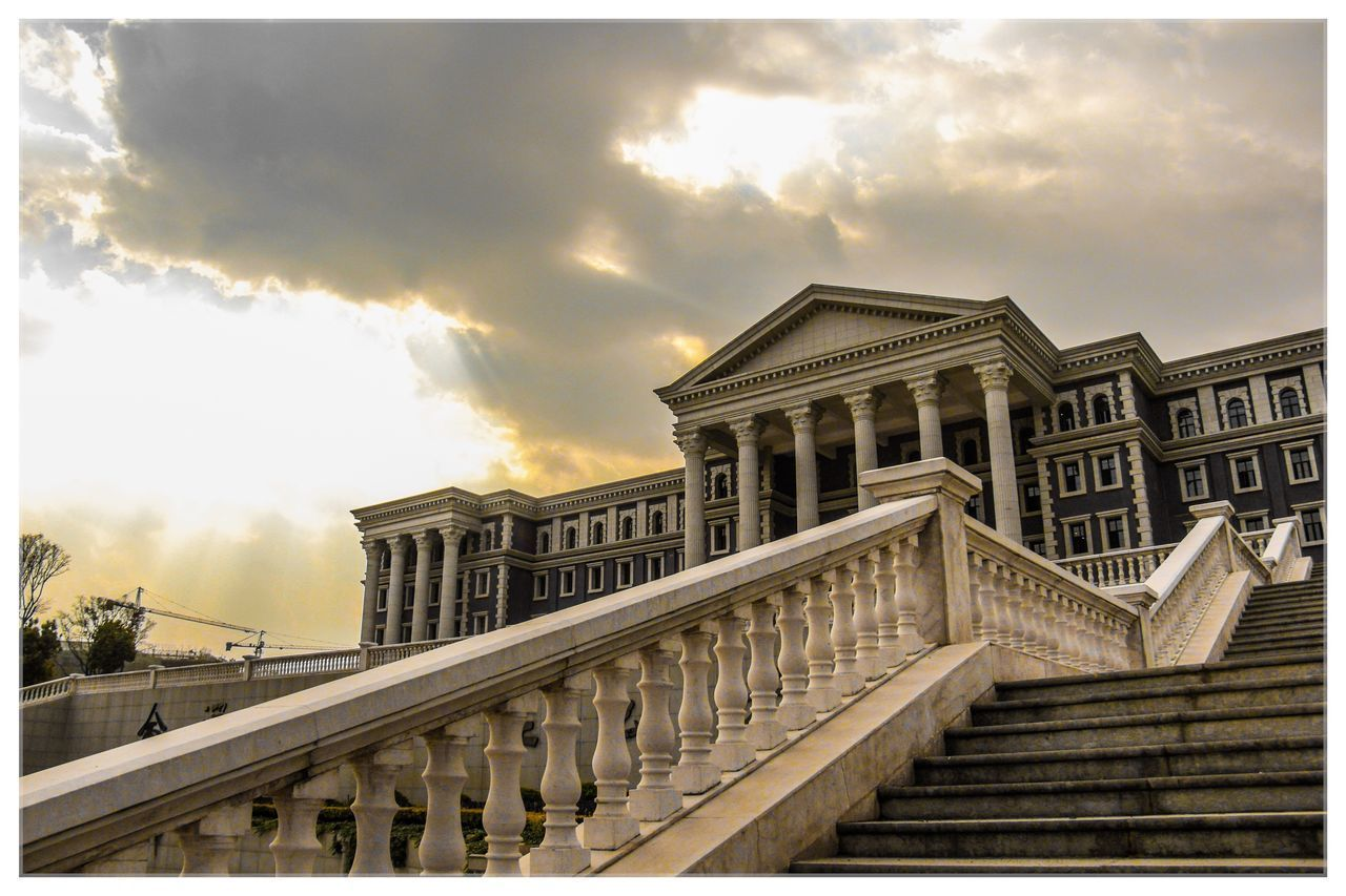 architecture, sky, cloud - sky, built structure, building exterior, auto post production filter, transfer print, nature, no people, staircase, railing, outdoors, day, low angle view, building, architectural column, city, steps and staircases, sunset, colonnade