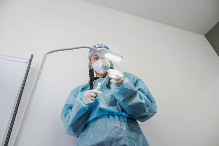 Low angle view of person wearing mask