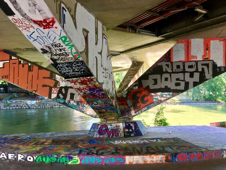 Graffiti Water Architecture Street Art Built Structure Multi Colored Bridge - Man Made Structure Day Outdoors No People The Street Photographer - 2017 EyeEm Awards The Graphic City