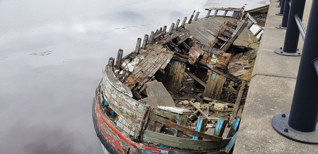 High angle view of abandoned boat in water