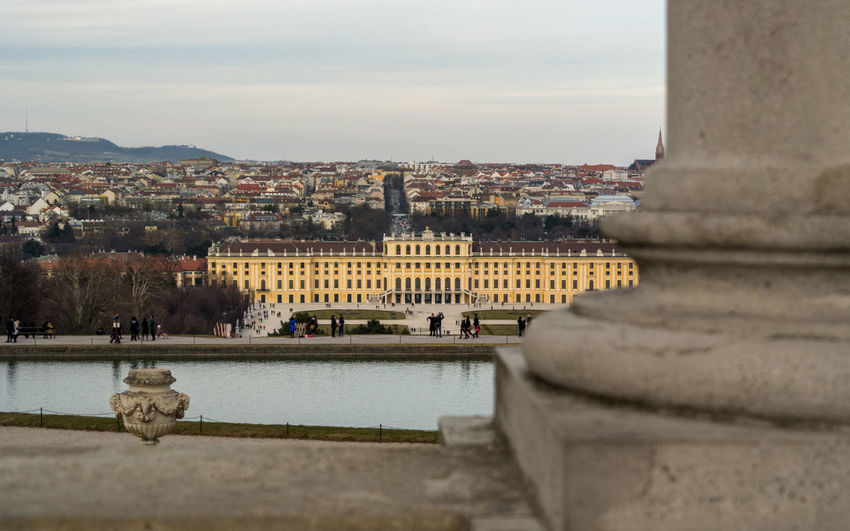 The grand and impressive Schonbrunn Palace, Vienna as viewed from its public gardens with old Vienna in the back ground. Vienna Architecture Austira Building Building Exterior Built Structure City Cityscape Day History Nature No People Outdoors Palace River Sky The Past Tourism Travel Travel Destinations Water