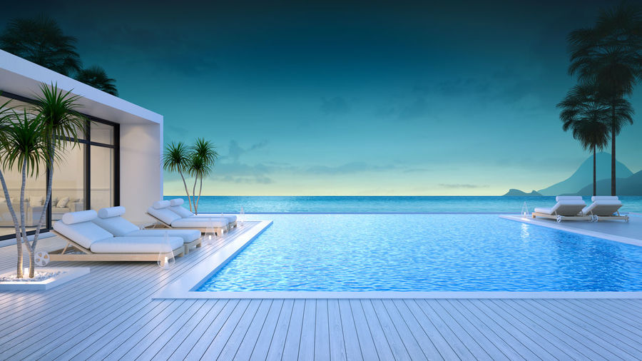 Summer ,beach lounge, sun loungers on sunbathing deck and private swimming pool at luxury villa