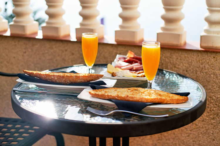Breakfast served with coffee, orange juice, croissant, toast bread and jam, selective focus. Sunny weather, no people Breakfast Food And Drink Morning Sunlight Breakfast Time Close-up Drink Food Food And Drink Fresh Hotel Hotel Breakfast No People Nobody Orange Juice  Pastries Pastry Ready-to-eat Restaurant Table Tablecloth Tasty Toast Bread Traditional Breakfast Typical Breakfast