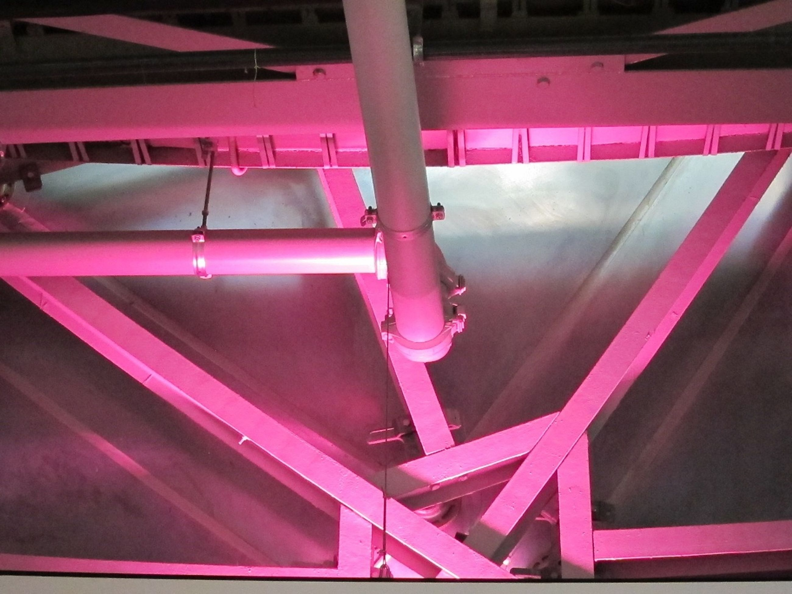 red, indoors, metal, low angle view, no people, close-up, high angle view, built structure, in a row, hanging, multi colored, railing, architecture, metallic, technology, equipment, day, arts culture and entertainment, pink color, industry