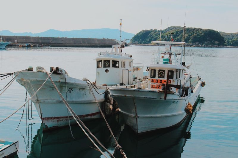Nautical Vessel Water Transportation Mode Of Transportation Moored Sky Sea Nature No People Rope Day Ship Outdoors Harbor Clear Sky Mountain Fishing Industry Sailboat Fishing Boat Anchored