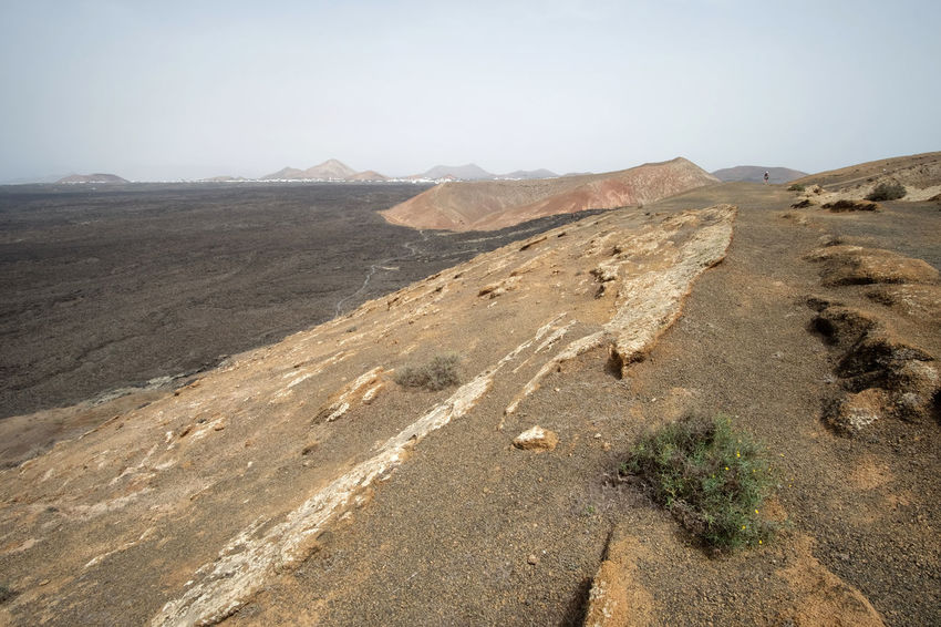 Landscape_Collection Lanzarote Lost In The Landscape Vulcan Arid Climate Beauty In Nature Day Desert Landscape Landscape_photography Lava Mountain Mountain Range Nature No People Outdoors Physical Geography Sand Dune Scenics Tranquility Volcanic Landscape Volcano