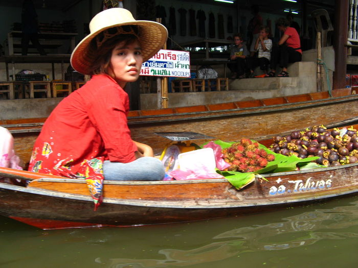 Portrait of woman on boat at floating market