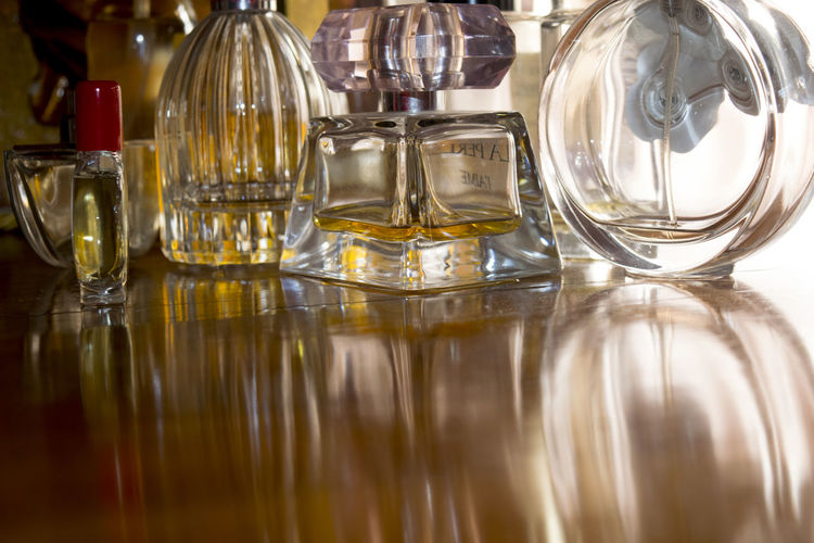 Close-Up Of Perfumes On Table