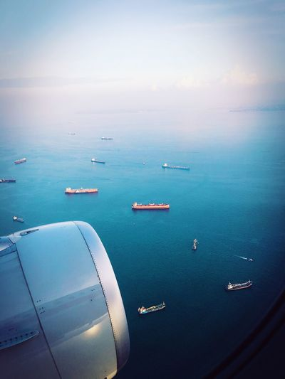 High angle view of airplane on sea against sky