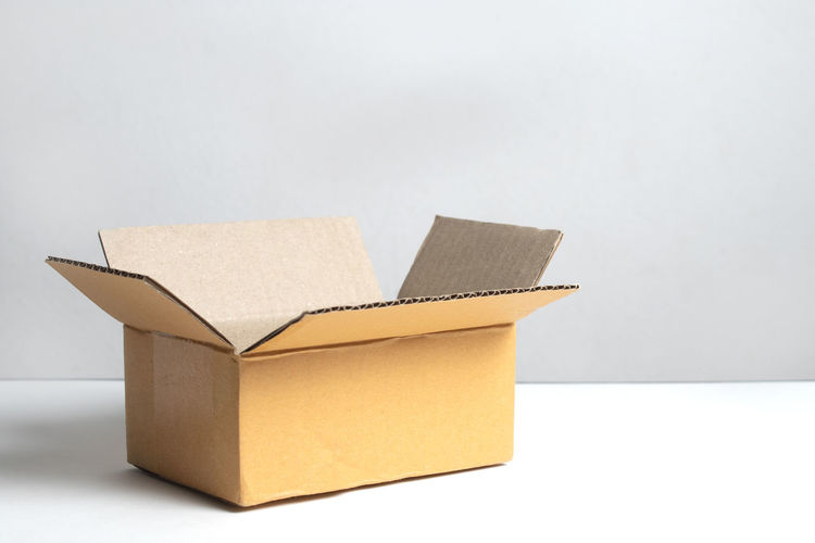 Close-up of paper box over white background
