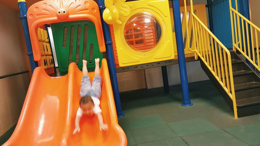 High angle view of boy playing on slide