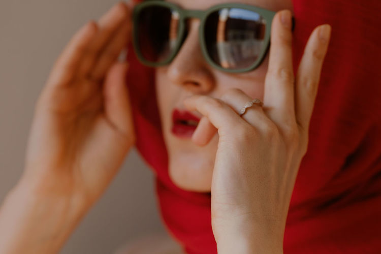Midsection of boy holding sunglasses