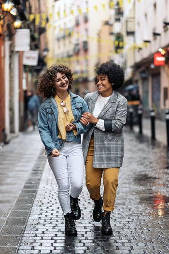 Women walking on street in rain