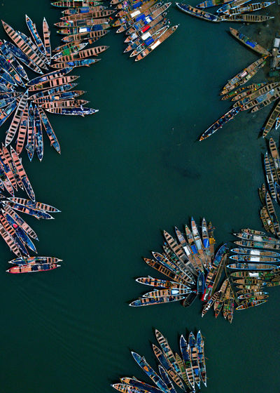 High angle view of canoes at a fishing harbor