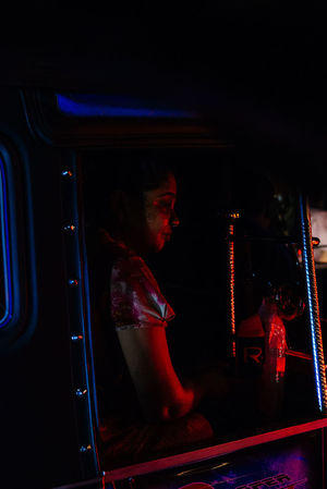 The streets were bustling and writhing with energy in Galle as Sri Lankans celebrated Vesak, the day of Buddah. Shooting from a Tuk Tuk in low light is extremely difficult in ever changing circumstances with light shifting every time traffic moves. The Portraitist - 2018 EyeEm Awards The Street Photographer - 2018 EyeEm Awards The Traveler - 2018 EyeEm Awards Commute Illuminated Land Vehicle Mode Of Transportation Night One Person Portrait Real People Sitting Transportation Tuk Tuk Young Men