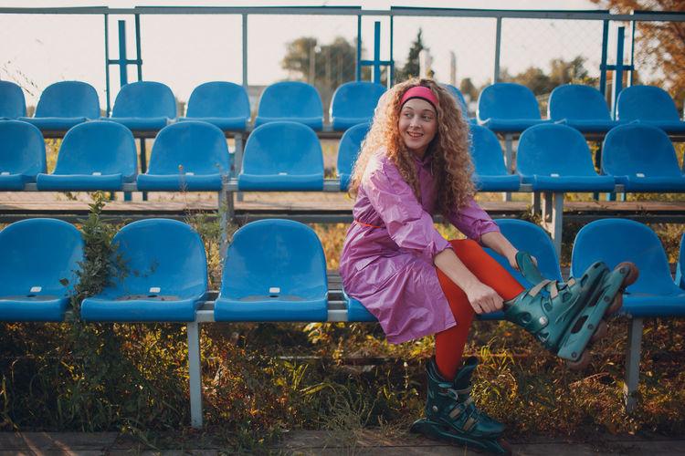 Portrait of smiling girl sitting on playground