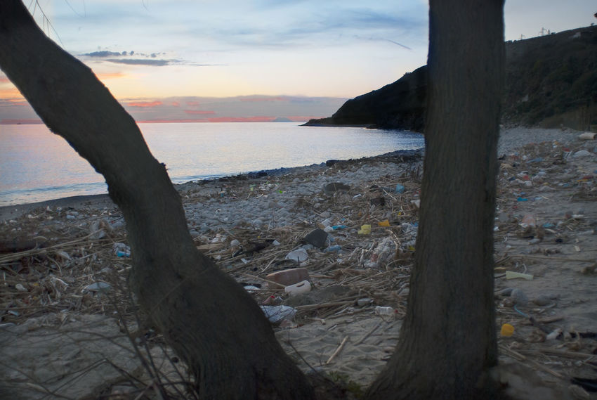 polluted beach at sunset Beach Day Horizon Over Water Nature No People Outdoors Polluted Pollution Sand Scenics Sea Sky Sunset Waste Water