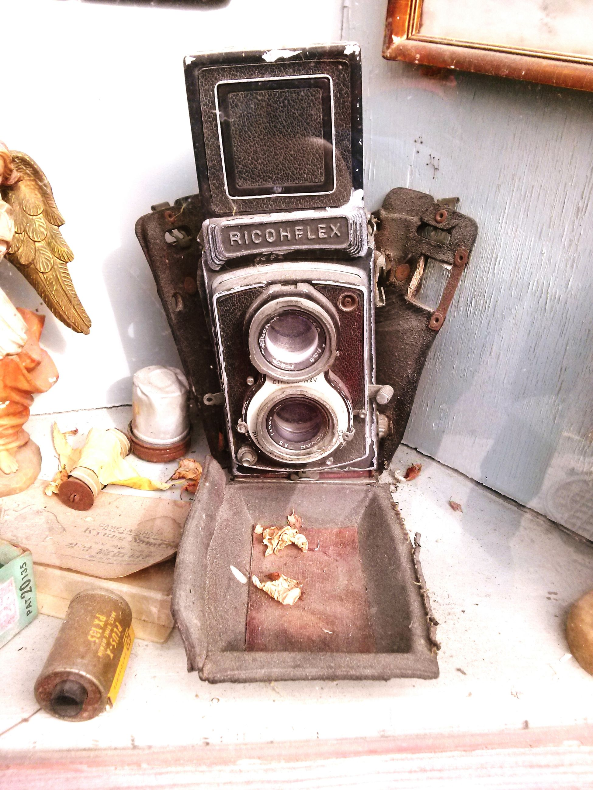 indoors, old, wood - material, old-fashioned, wall - building feature, technology, retro styled, metal, high angle view, still life, obsolete, antique, table, the past, close-up, abandoned, work tool, day, wooden, equipment