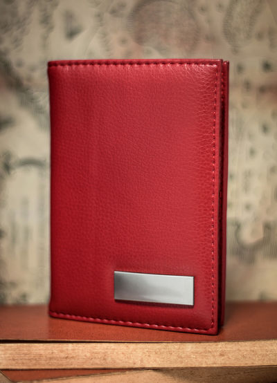 Red passport wallet on vintage background. Template of leather wallet for your design. Business Leather Passport Passports Wallet WalletLeather Background Bag Blank Book Card Diary Focus On Foreground Furniture Grunge Holder Holders Leather Pocket  Purse Purses Red Still Life Table Vintage