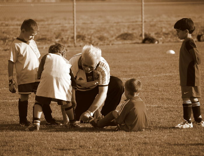 Adult Boys Child Childhood Day Elementary Age Grass Leisure Activity Medium Group Of People Outdoors People Playing Real People Soccer Soccer Field Soccer Player Soccer Uniform Sport Sports Team Team Sport Teamwork Togetherness The Great Outdoors - 2017 EyeEm Awards