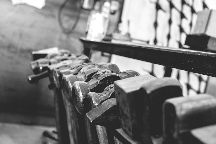 Close-up of hammers at blacksmith shop