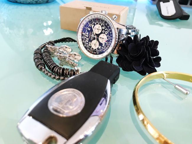 Table High Angle View Indoors  No People Close-up Technology Day Amggts Key Breitling Watch Wedding Kara Gold Burberry Cufflinks
