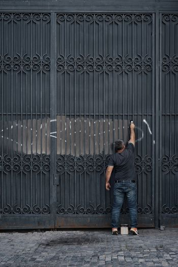 Architecture Working Painting One Person One Man Only Men People Full Length Standing Men Copy Space Corrugated Iron Gate Lock Iron Locked Closed Safe