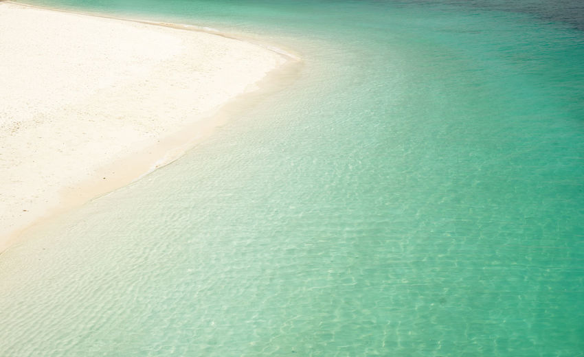 Crystal clear and turquoise sea water of the tropical sea . Asian  Bay Beach Beautifully  Blue Bright Caribbean Clear Coast Color Crystal Destination Dinghy Famous Green Holiday Island Lagoon Malaysia Mediterranean  Nature Nobody Ocean Outdoor Paradise Picturesque Rawa Relax Sand Scenery Scenic Sea Seascape Sky Summer Sunlight Sunny Sunshine Tourism Tranquil Travel Tropic Tropical Turquoise Vacation View Water White