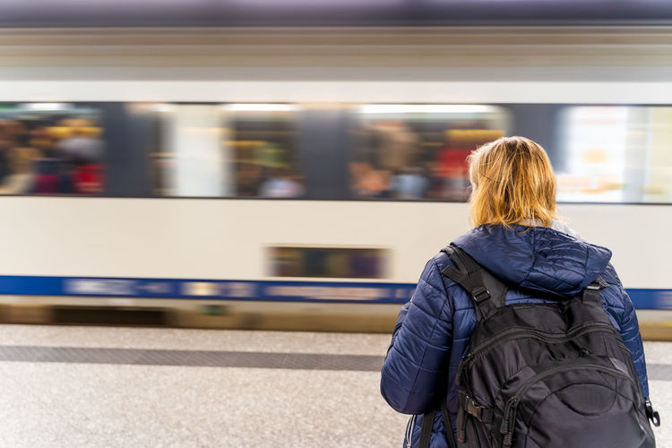 Rear view of woman on train at railroad station
