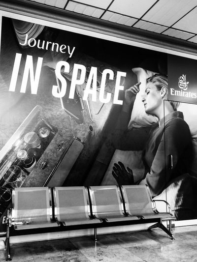 Journey in Space! Airport One Person Text Communication Lifestyles Western Script Real People Young Adult Seat