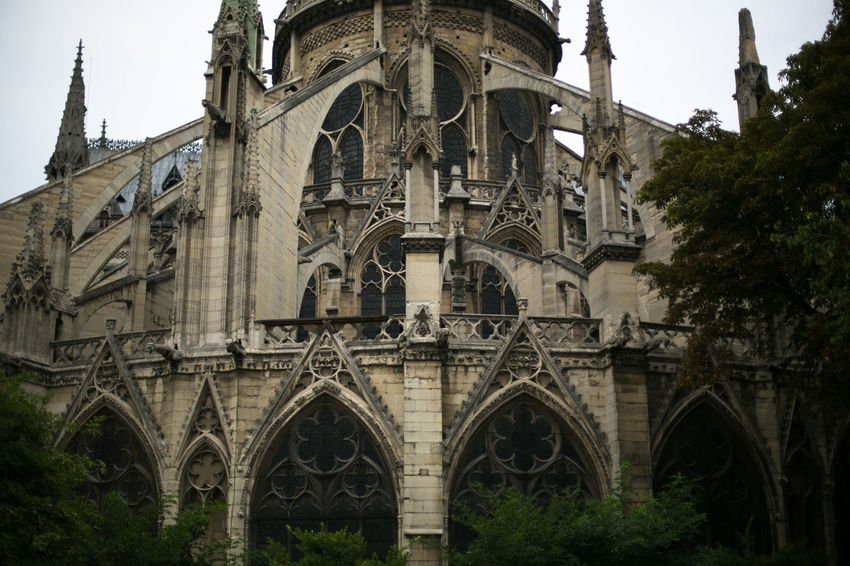 Details of Notre Dame de Paris cathedral in Paris, France Architecture Beautiful Cathedral Church Economy France Notre Dame De Paris Paris Statue Travel Architectural Feature Architecture Building Exterior Dark Light Day Details History Outdoors Parisian Place Of Worship Real Estate Religion Spirituality Travel Destinations Window