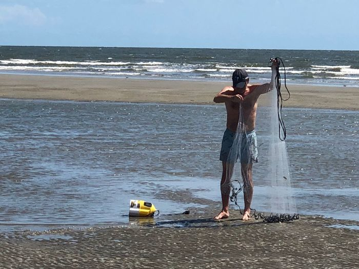 Preparing the cast net for the throw Sportsman Casting Bait Casting Casting Net Water Sea Beach Land Real People Lifestyles Full Length One Person Outdoors Standing Beauty In Nature Men Sky